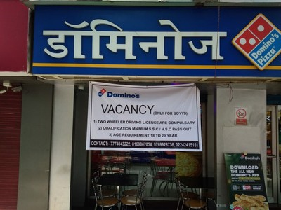 A banner outside a Domino's pizza franchise in India seeking delivery personnel reads: VACANCY (Only for boyys)