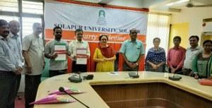 MoU between PAH Solapur University & CIS-A2K
